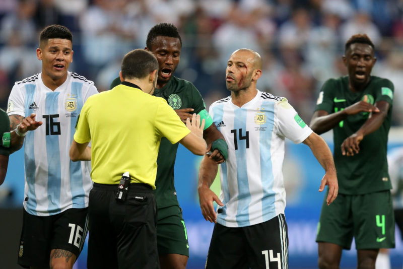 SAINT PETERSBURG, RUSSIA - JUNE 26:  Javier Mascherano of Argentina and John Obi Mikel of Nigeria argue with Referee Cuneyt Cakir during the 2018 FIFA World Cup Russia group D match between Nigeria and Argentina at Saint Petersburg Stadium on June 26, 2018 in Saint Petersburg, Russia.  (Photo by Gabriel Rossi/Getty Images)