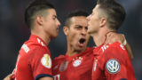 Bayern Munich's Polish forward Robert Lewandowski(R) celebrates scoring with his teammates Colombian midfielder James Rodriguez (L) and Spanish midfielder Thiago Alcantara during the German Cup DFB Pokal final football match FC Bayern Munich vs Eintracht Frankfurt at the Olympic Stadium in Berlin on May 19, 2018. / AFP PHOTO / Christof STACHE / RESTRICTIONS: ACCORDING TO DFB RULES IMAGE SEQUENCES TO SIMULATE VIDEO IS NOT ALLOWED DURING MATCH TIME. MOBILE (MMS) USE IS NOT ALLOWED DURING AND FOR FURTHER TWO HOURS AFTER THE MATCH. == RESTRICTED TO EDITORIAL USE == FOR MORE INFORMATION CONTACT DFB DIRECTLY AT +49 69 67880   /