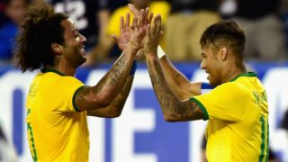 FOXBORO, MA - SEPTEMBER 08: Marcelo #6 and Neymar #10 of Brazil react after Neymar scored a goal during an international friendly against the United States at Gillette Stadium on September 8, 2015 in Foxboro, Massachusetts.   Billie Weiss/Getty Images/AFP