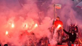 Supporters of VFB Stuttgart set alight Bengal fireworks in their stalls in the match of VFBStuttgart against FCHomburg in the first round of the DFB Cup at Waldstadion in Homburg, Germany, 20 August 2016. Photo: Oliver Dietze/dpa (EMBARGO CONDITIONS - ATTENTION: The DFB prohibits the utilisation and publication of sequential pictures on the internet and other online media during the match (including half-time). ATTENTION: BLOCKING PERIOD! The DFB permits the further utilisation and publication of the pictures for mobile services (especially MMS) and for DVB-H and DMB only after the end of the match.)