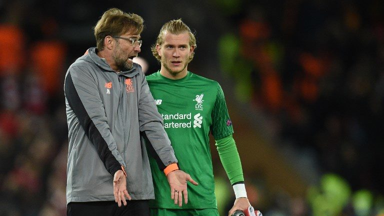 Liverpool's German manager Jurgen Klopp (L) talks with Liverpool's German goalkeeper Loris Karius after the UEFA Champions League first leg semi-final football match between Liverpool and Roma at Anfield stadium in Liverpool, north west England on April 24, 2018. / AFP PHOTO / Oli SCARFF