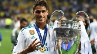 Real Madrid's French defender Raphael Varaneposes with the trophy after winning the UEFA Champions League final football match between Liverpool and Real Madrid at the Olympic Stadium in Kiev, Ukraine, on May 26, 2018. / AFP PHOTO / FRANCK FIFE