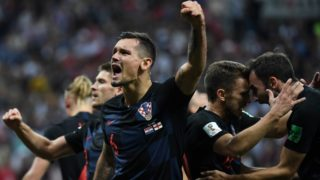 Croatia's defender Dejan Lovren (C) celebrates with teammates at the end of the Russia 2018 World Cup semi-final football match between Croatia and England at the Luzhniki Stadium in Moscow on July 11, 2018. / AFP PHOTO / YURI CORTEZ / RESTRICTED TO EDITORIAL USE - NO MOBILE PUSH ALERTS/DOWNLOADS