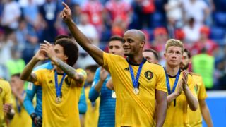 Belgium's defender Vincent Kompany (2ndR) and teammates celebrate their victory at the end of their Russia 2018 World Cup play-off for third place football match between Belgium and England at the Saint Petersburg Stadium in Saint Petersburg on July 14, 2018. / AFP PHOTO / Giuseppe CACACE / RESTRICTED TO EDITORIAL USE - NO MOBILE PUSH ALERTS/DOWNLOADS