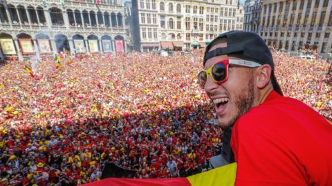 Belgium's captain Eden Hazard celebrates at the Grand Place/Grote Markt in Brussels city center, as Belgian national football team Red Devils arrive to celebrate with supporters at the balcony of the city hall after reaching the semi-finals and winning the bronze medal at the Russia 2018 World Cup on July 15, 2018. / AFP PHOTO / BELGA / Yves HERMAN / Belgium OUT