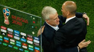 Belgium's coach Roberto Martinez (R) congratulates France's coach Didier Deschamps (L) at the end of the Russia 2018 World Cup semi-final football match between France and Belgium at the Saint Petersburg Stadium in Saint Petersburg on July 10, 2018. / AFP PHOTO / Adrian DENNIS / RESTRICTED TO EDITORIAL USE - NO MOBILE PUSH ALERTS/DOWNLOADS