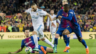 BARCELONA, SPAIN - MAY 06: Karim Benzema (2nd from L) of Real Madrid vies for the ball with Sergio Busquets Burgos (L) of FC Barcelona during the La Liga match between Barcelona and Real Madrid at Camp Nou on May 6, 2018 in Barcelona, Spain. (Photo by Power Sport Images/Getty Images)