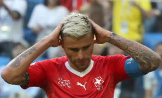 ST PETERSBURG, RUSSIA - JULY 3, 2018: Switzerland's Valon Behrami reacts after the Knockout Stage Round of 16 football match between Sweden and Switzerland at Saint Petersburg Stadium (Krestovsky Stadium) at FIFA World Cup Russia 2018; Sweden won 1-0. Alexander Demianchuk/TASS (Photo by Alexander DemianchukTASS via Getty Images)