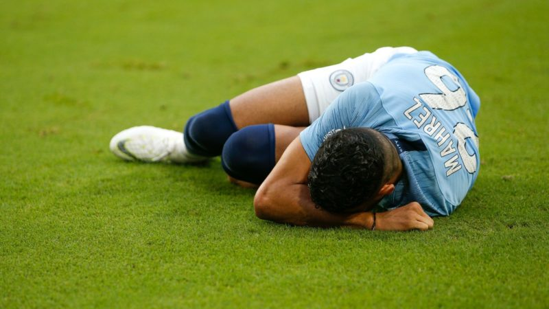 MIAMI, FL - JULY 28: Riyad Mahrez #26 of Manchester City reacts after being injured against Bayern Munich during the first half of the International Champions Cup at Hard Rock Stadium on July 28, 2018 in Miami, Florida.   Michael Reaves/Getty Images/AFP