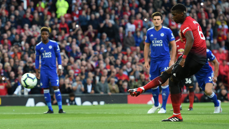 Manchester United's French midfielder Paul Pogba (R) scores the opening penalty during the English Premier League football match between Manchester United and Leicester City at Old Trafford in Manchester, north west England, on August 10, 2018. / AFP PHOTO / Oli SCARFF / RESTRICTED TO EDITORIAL USE. No use with unauthorized audio, video, data, fixture lists, club/league logos or 'live' services. Online in-match use limited to 120 images. An additional 40 images may be used in extra time. No video emulation. Social media in-match use limited to 120 images. An additional 40 images may be used in extra time. No use in betting publications, games or single club/league/player publications. /
