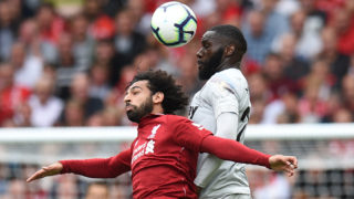 West Ham United's French defender Arthur Masuaku (R) vies with Liverpool's Egyptian midfielder Mohamed Salah during the English Premier League football match between Liverpool and West Ham United at Anfield in Liverpool, north west England on August 12, 2018. / AFP PHOTO / Oli SCARFF / RESTRICTED TO EDITORIAL USE. No use with unauthorized audio, video, data, fixture lists, club/league logos or 'live' services. Online in-match use limited to 120 images. An additional 40 images may be used in extra time. No video emulation. Social media in-match use limited to 120 images. An additional 40 images may be used in extra time. No use in betting publications, games or single club/league/player publications. /