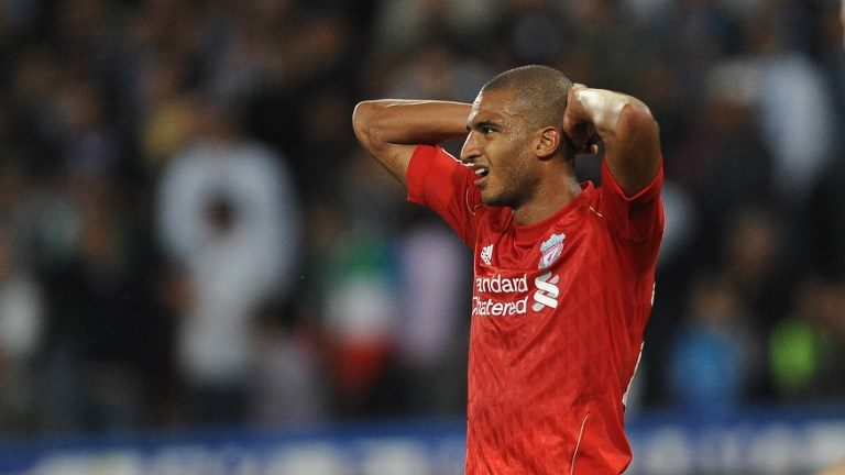 Liverpool's French forward David Ngog reacts after missing a goal opportunity against Napoli during their Europa League football match at San Paolo Stadium in Naples on October 21, 2010. The match ended in a 0-0 draw. AFP PHOTO / ANDREAS SOLARO / AFP PHOTO / ANDREAS SOLARO