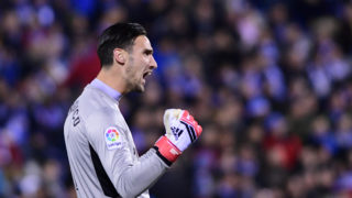 Sevilla's Spanish goalkeeper Sergio Rico Gonzalez celebrates after teammate Sevilla's Colombian forward Luis Muriel scored a goal during the Spanish 'Copa del Rey' (King's cup) first leg semi-final football match between Leganes and Sevilla FC at the Estadio Municipal Butarque in Leganes on January 31, 2018. / AFP PHOTO / PIERRE-PHILIPPE MARCOU