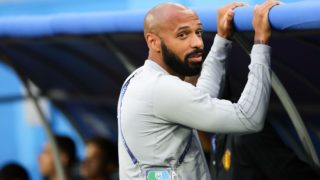 10 July 2018, Russia, St. Petersburg: Soccer, FIFA World Cup 2018, final round, semi-final: France vs Belgium at the Saint Petersburg Stadium.Belgium's assistant coach Thierry Henry stands next to the bench prior to the match. Photo: Christian Charisius/dpa