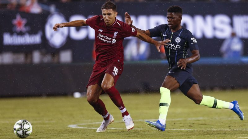 EAST RUTHERFORD, NJ - JULY 25: Marko Grujic #16 of Liverpool fights for the ball with Tomiwa Dele-Bashiru #72 of Manchester City during their match at MetLife Stadium on July 25, 2018 in East Rutherford, New Jersey.   Jeff Zelevansky/Getty Images/AFP