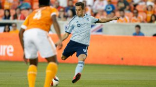 HOUSTON, TX - APRIL 25: Krisztian Nemeth #9 of Sporting KC scores a goal against the Houston Dynamo duirng their game at BBVA Compass Stadium on April 25, 2015 in Houston, Texas.   Scott Halleran/Getty Images/AFP