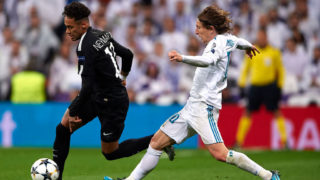 MADRID, SPAIN - FEBRUARY 14:  Neymar of Paris Saint-Germain is tackled by Luka Modric of Real Madrid during the UEFA Champions League Round of 16 First Leg match between Real Madrid and Paris Saint-Germain at Bernabeu on February 14, 2018 in Madrid, Spain.  (Photo by Manuel Queimadelos Alonso/Getty Images)