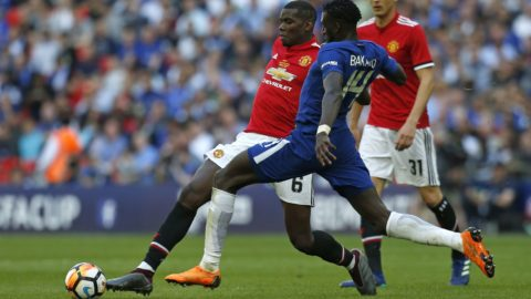 Manchester United's French midfielder Paul Pogba (L) vies with Chelsea's French midfielder Tiemoue Bakayoko during the English FA Cup final football match between Chelsea and Manchester United at Wembley stadium in London on May 19, 2018. / AFP PHOTO / Ian KINGTON / NOT FOR MARKETING OR ADVERTISING USE / RESTRICTED TO EDITORIAL USE