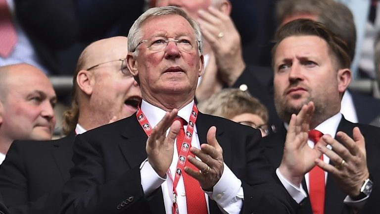Manchester United's former manager Alex Ferguson watches from the crowd ahead of the kick off of the English FA Cup semi-final football match between Tottenham Hotspur and Manchester United at Wembley Stadium in London, on April 21, 2018. / AFP PHOTO / Glyn KIRK / NOT FOR MARKETING OR ADVERTISING USE / RESTRICTED TO EDITORIAL USE