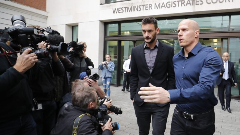 Tottenham Hotspur's French goalkeeper Hugo Lloris (2R) leaves after attending Westminster Magistrates Court in central London on September 12, 2018.  France's World Cup-winning goalkeeper Hugo Lloris avoided jail but received a 20-month driving ban and a £50,000 ($65,000) fine on Wednesday for drink-driving in central London. / AFP PHOTO / Tolga AKMEN