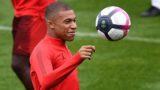 """Paris Saint-Germain's French forward Kylian Mbappe takes part in a training session at the team's """"Camp des Loges"""" training grounds in Saint-Germain-en-Laye, west of Paris, on September 13, 2018, on the eve of the French L1 football match between Paris Saint-Germain (PSG) and Saint-Etienne (ASSE). / AFP PHOTO / Anne-Christine POUJOULAT"""