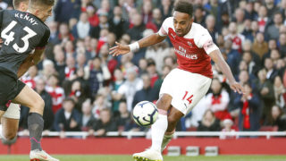 Arsenal's Gabonese striker Pierre-Emerick Aubameyang scores his team's second goal during the English Premier League football match between Arsenal and Everton at the Emirates Stadium in London on September 23, 2018.  / AFP PHOTO / Adrian DENNIS / RESTRICTED TO EDITORIAL USE. No use with unauthorized audio, video, data, fixture lists, club/league logos or 'live' services. Online in-match use limited to 120 images. An additional 40 images may be used in extra time. No video emulation. Social media in-match use limited to 120 images. An additional 40 images may be used in extra time. No use in betting publications, games or single club/league/player publications. /