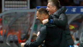Berlin's Hungarian head coach Pal Dardai (L) celebrates with his assistant coach Rainer Widmayer at the final whistle of the German first division Bundesliga football match Hertha Berlin v Bayern Munich at the Olympic stadium in Berlin on September 28, 2018.  Hertha Berlin won the match 2-0. / AFP PHOTO / Odd ANDERSEN / DFL REGULATIONS PROHIBIT ANY USE OF PHOTOGRAPHS AS IMAGE SEQUENCES AND/OR QUASI-VIDEO