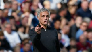 Manchester United's Portuguese manager Jose Mourinho gestures from the touchline during the English Premier League football match between West Ham United and Manchester United at The London Stadium, in east London on September 29, 2018. / AFP PHOTO / Ian KINGTON / RESTRICTED TO EDITORIAL USE. No use with unauthorized audio, video, data, fixture lists, club/league logos or 'live' services. Online in-match use limited to 120 images. An additional 40 images may be used in extra time. No video emulation. Social media in-match use limited to 120 images. An additional 40 images may be used in extra time. No use in betting publications, games or single club/league/player publications. /