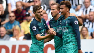 NEWCASTLE UPON TYNE, ENGLAND - AUGUST 11:  Dele Alli of Tottenham Hotspur celebrates with teammates Harry Kane and Ben Davies after scoring his team's second goal during the Premier League match between Newcastle United and Tottenham Hotspur at St. James Park on August 11, 2018 in Newcastle upon Tyne, United Kingdom.  (Photo by Tony Marshall/Getty Images)