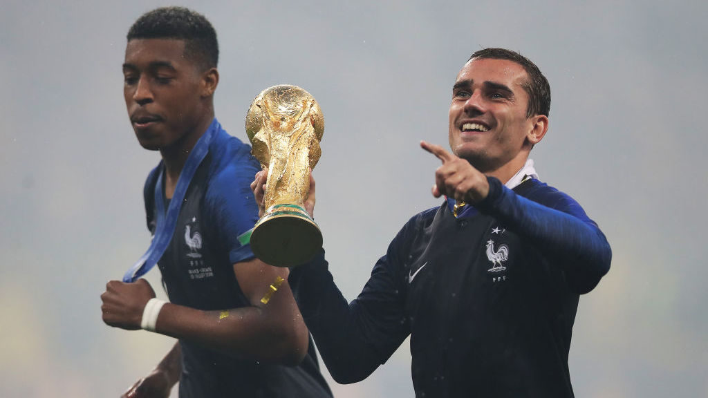 MOSCOW, RUSSIA - JULY 15: Presnel Kimpembe and Antoine Griezmann of France are seen with the trophy during the 2018 FIFA World Cup Russia Final between France and Croatia at Luzhniki Stadium on July 15, 2018 in Moscow, Russia. (Photo by Ian MacNicol/Getty Images)