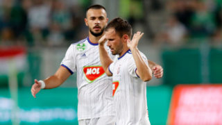 BUDAPEST, HUNGARY - SEPTEMBER 2: (r-l) Szabolcs Huszti of MOL Vidi FC celebrates his goal moderated and holds up his hands in front of Tamas Krisztian of MOL Vidi FC during the Hungarian OTP Bank Liga match between Ferencvarosi TC and MOL Vidi FC at Groupama Arena on September 2, 2018 in Budapest, Hungary. (Photo by Laszlo Szirtesi/Getty Images)