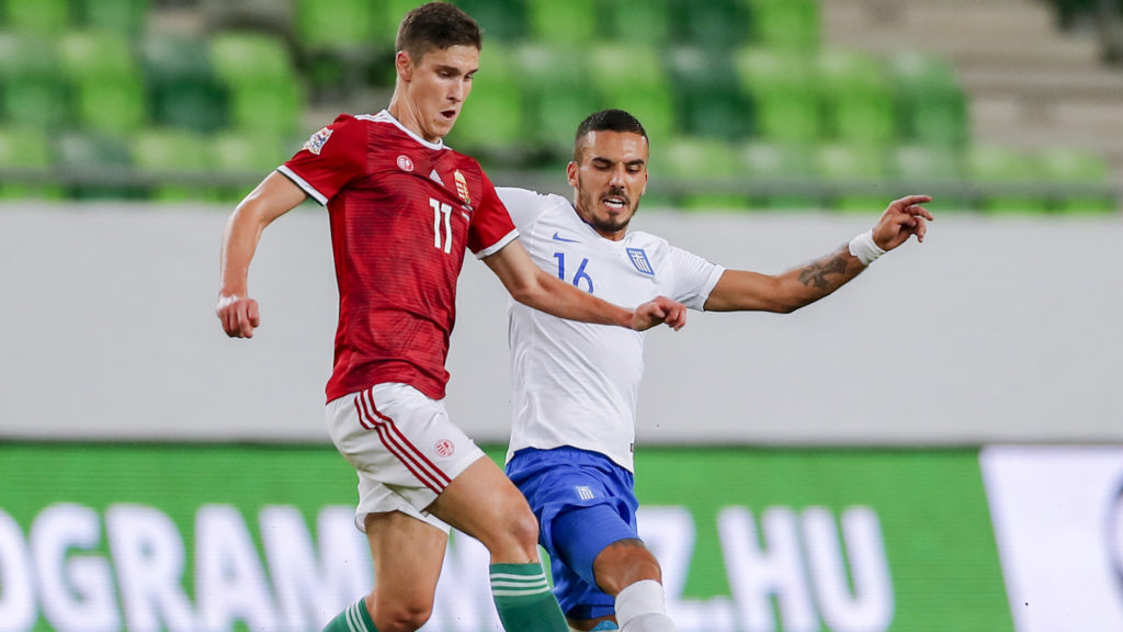 BUDAPEST, HUNGARY - SEPTEMBER 11: (r-l) Dimitris Kourbelis of Greece tackles Roland Sallai of Hungary during the UEFA Nations League group stage match between Hungary and Greece at Groupama Arena on September 11, 2018 in Budapest, Hungary. (Photo by Laszlo Szirtesi/Getty Images)