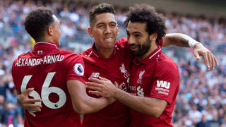 LONDON, ENGLAND - SEPTEMBER 15: Roberto Firmino of Liverpool celebrates his goal with Trent Alexander-Arnold and Mohamed Salah during the Premier League match between Tottenham Hotspur and Liverpool FC at Wembley Stadium on September 15, 2018 in London, United Kingdom. (Photo by Visionhaus/Getty Images)