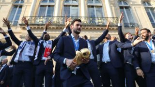 France's goalkeeper Hugo Lloris (C)  holds the winner's trophy in front of his team mates gesture during an official reception at the Elysee Presidential Palace on July 16, 2018 in Paris after French players won the Russia 2018 World Cup final football match. France celebrated their second World Cup win 20 years after their maiden triumph on July 15, 2018, overcoming a passionate Croatia side 4-2 in one of the most gripping finals in recent history. / AFP PHOTO / POOL / LUDOVIC MARIN