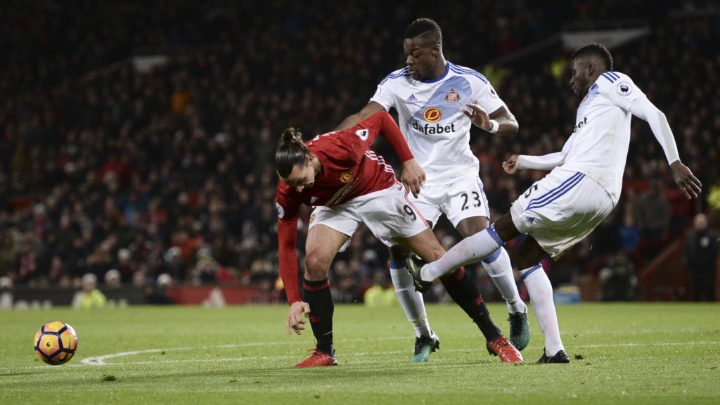 Sunderland's Senegalese defender Papy Djilobodji (R) vies with Manchester United's Swedish striker Zlatan Ibrahimovic (L) in the box with no foul awarded during the English Premier League football match between Manchester United and Sunderland at Old Trafford in Manchester, north west England, on December 26, 2016. / AFP PHOTO / Oli SCARFF / RESTRICTED TO EDITORIAL USE. No use with unauthorized audio, video, data, fixture lists, club/league logos or 'live' services. Online in-match use limited to 75 images, no video emulation. No use in betting, games or single club/league/player publications.  /