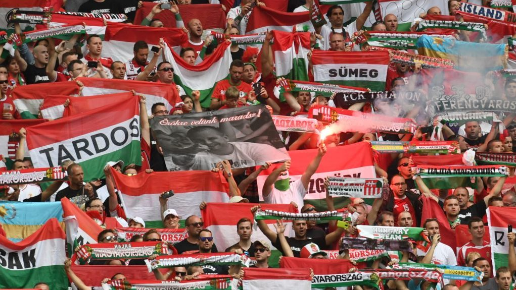 Hungary's supporters hold their team banner ahead of the Euro 2016 group F football match between Iceland and Hungary at the Stade Velodrome in Marseille on June 18, 2016. / AFP PHOTO / BORIS HORVAT