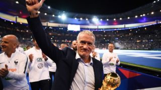 France's coach Didier Deschamps holds the 2018 World Cup trophy as he celebrates during a ceremony for the victory of the 2018 World Cup at the end of the UEFA Nations League football match between France and Netherlands at the Stade de France stadium, in Saint-Denis, northern of Paris, on September 9, 2018. / AFP PHOTO / FRANCK FIFE