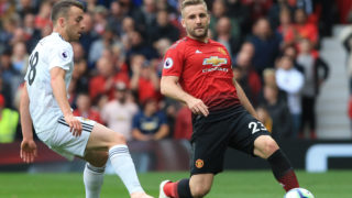 Manchester United's English defender Luke Shaw (R) vies with Wolverhampton Wanderers' Portuguese midfielder Diogo Jota during the English Premier League football match between Manchester United and Wolverhampton Wanderers at Old Trafford in Manchester, north west England, on September 22, 2018. (Photo by Lindsey PARNABY / AFP) / RESTRICTED TO EDITORIAL USE. No use with unauthorized audio, video, data, fixture lists, club/league logos or 'live' services. Online in-match use limited to 120 images. An additional 40 images may be used in extra time. No video emulation. Social media in-match use limited to 120 images. An additional 40 images may be used in extra time. No use in betting publications, games or single club/league/player publications. /