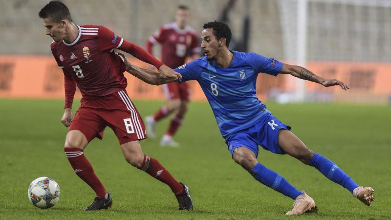 Hungary's Midfielder Adam Nagy (L) vies with Greece's Midfielder Carlos Zeca during the UEFA Nations League football match between Greece and Hungary at the Karaiskaki stadium in Athens on October 12, 2018. (Photo by ANGELOS TZORTZINIS / AFP)