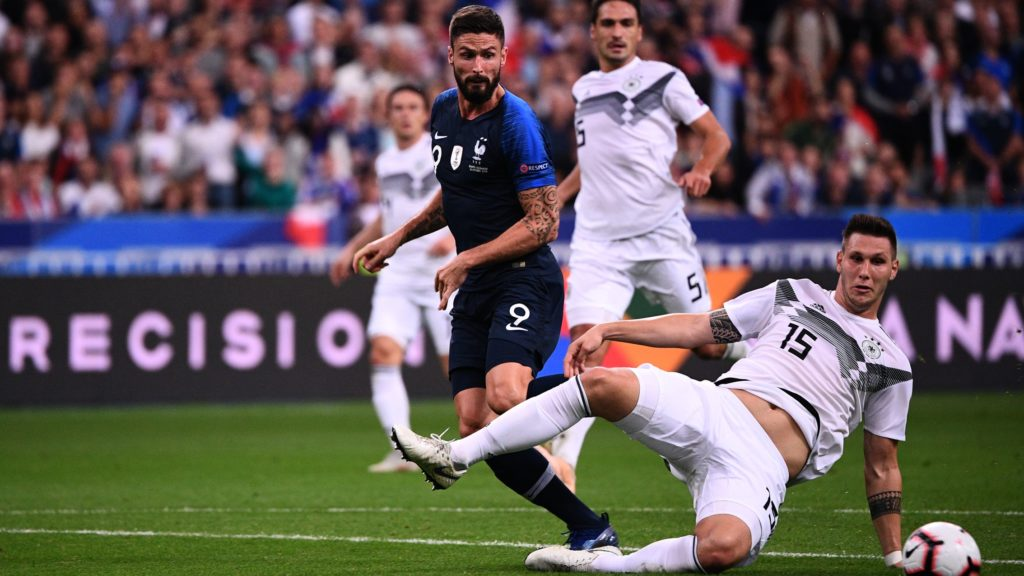Germany's defender Niklas Suele (R) falls past France's forward Olivier Giroud during the UEFA Nations League football match between France and Germany at the Stade de France in Saint-Denis, near Paris on October 16, 2018. (Photo by FRANCK FIFE / AFP)