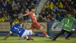 Real Madrid's Spanish midfielder Marco Asensio (C) vies with UD Melilla's Spanish defender Mohamed Mahanan (L) and Spanish goalkeeper Dani Barrio during the Spanish King's Cup football match between UD Melilla and Real Madrid CF at the Alvarez Claro municipal stadium in the autonomous city of Melilla on October 31, 2018. (Photo by JORGE GUERRERO / AFP)