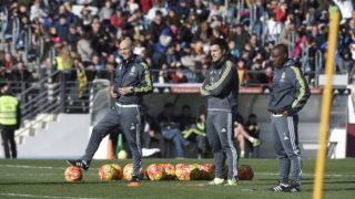 Staff members of Real Madrid bettoni (david), solari (santiago) and msaidie (hamidou) are pictured during a training session at Valdebebas training ground on January 5, 2016 in Madrid, Spain.