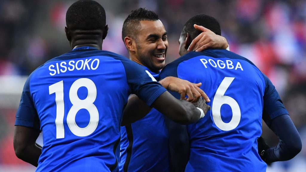 France's midfielder Paul Pogba (R) celebrates with France's midfielder Dimitri Payet (C) and France's midfielder Moussa Sissoko after scoring a goal during the 2018 World Cup group A qualifying football match between France and Sweden at the Stade de France in Saint-Denis, north of Paris, on November 11, 2016. / AFP PHOTO / FRANCK FIFE