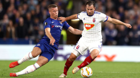 LONDON, ENGLAND - OCTOBER 04:  Szabolcs Huszti of MOL Vidi FC holds off Ross Barkley of Chelsea  during the UEFA Europa League Group L match between Chelsea and Vidi FC at Stamford Bridge on October 4, 2018 in London, United Kingdom.  (Photo by Bryn Lennon/Getty Images)