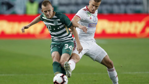 BUDAPEST, HUNGARY - OCTOBER 6: (r-l) Attila Haris of DVSC tackles Ivan Petryak of Ferencvarosi TC during the Hungarian OTP Bank Liga match between Ferencvarosi TC and DVSC at Groupama Arena on October 6, 2018 in Budapest, Hungary. (Photo by Laszlo Szirtesi/Getty Images)