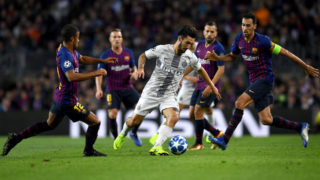 BARCELONA, SPAIN - OCTOBER 24: Matteo Politano of Inter Milan in action while under pressure from Rafinha, Arthur, Jordi Alba and Sergio Busquets of Barcelona during the Group B match of the UEFA Champions League between FC Barcelona and FC Internazionale at Camp Nou on October 24, 2018 in Barcelona, Spain.  (Photo by David Ramos/Getty Images)