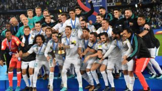 Real Madrid players celebrate with the FIFA Club World Cup trophy following their victory in the final football match against Gremio at Zayed Sports City Stadium in the Emirati capital Abu Dhabi on December 16, 2017. - Real Madrid defeated Gremio 1-0 to lift the FIFA Club World Cup for the third time in their history. (Photo by Giuseppe CACACE / AFP)