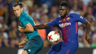 "Barcelona's French defender Samuel Umtiti (R) vies with Real Madrid's Welsh forward Gareth Bale (L) during the Spanish Supercup first leg football match FC Barcelona vs Real Madrid at the Camp Nou stadium in Barcelona on August 13, 2017. (Photo by LLUIS GENE / AFP) / ""The erroneous mention[s] appearing in the metadata of this photo by LLUIS GENE has been modified in AFP systems in the following manner: [Barcelona's French defender Samuel Umtiti] instead of [Barcelona's Poruguese defender Nelson Semedo]. Please immediately remove the erroneous mention[s] from all your online services and delete it (them) from your servers. If you have been authorized by AFP to distribute it (them) to third parties, please ensure that the same actions are carried out by them. Failure to promptly comply with these instructions will entail liability on your part for any continued or post notification usage. Therefore we thank you very much for all your attention and prompt action. We are sorry for the inconvenience this notification may cause and remain at your disposal for any further information you may require."""