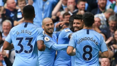 Manchester City's Argentinian striker Sergio Aguero (2R) celebrates scoring their third goal with team-mates (L-R) Manchester City's Brazilian striker Gabriel Jesus, Manchester City's Spanish midfielder David Silva, Manchester City's French defender Benjamin Mendy and Manchester City's German midfielder Ilkay Gundogan during the English Premier League football match between Manchester City and Huddersfield Town at the Etihad Stadium in Manchester, north west England, on August 19, 2018. (Photo by Lindsey PARNABY / AFP) / RESTRICTED TO EDITORIAL USE. No use with unauthorized audio, video, data, fixture lists, club/league logos or 'live' services. Online in-match use limited to 120 images. An additional 40 images may be used in extra time. No video emulation. Social media in-match use limited to 120 images. An additional 40 images may be used in extra time. No use in betting publications, games or single club/league/player publications. /