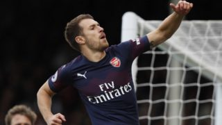 Arsenal's Welsh midfielder Aaron Ramsey celebrates after scoring the team's third goal during the English Premier League football match between Fulham and Arsenal at Craven Cottage in London on October 7, 2018. (Photo by Adrian DENNIS / AFP) / RESTRICTED TO EDITORIAL USE. No use with unauthorized audio, video, data, fixture lists, club/league logos or 'live' services. Online in-match use limited to 120 images. An additional 40 images may be used in extra time. No video emulation. Social media in-match use limited to 120 images. An additional 40 images may be used in extra time. No use in betting publications, games or single club/league/player publications. /